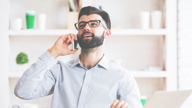 man on the phone talking - appointment setting outsourcing